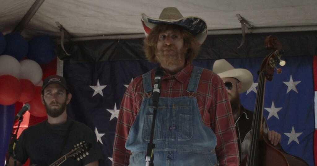 borat travestito da cantante country